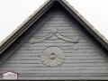 Fassadengestaltung aus Naturschiefer mit Ornamentgestaltung
