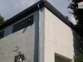 Dachabdichtungen mit Bitumenschweißbahnen sowie Attikaverkleidung mit spanischem Naturschiefer